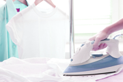 Ironing services in chesterfield, woman ironing a shirt for customer